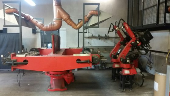 2009 Comau robot welding system with 2 robots, turntable H-Wender