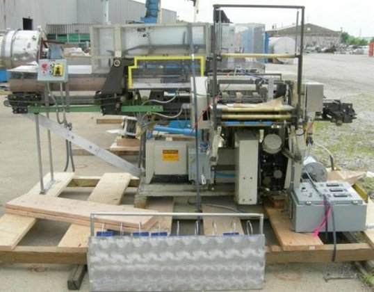PACKAGE MACHINERY TYPE FA OVERWRAPPER.