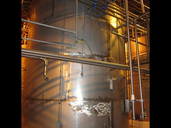 APPROXIMATELY 13,000 GALLON VERTICAL STAINLESS