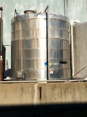 APPROXIMATELY 5,900 GALLON VERTICAL STAINLESS