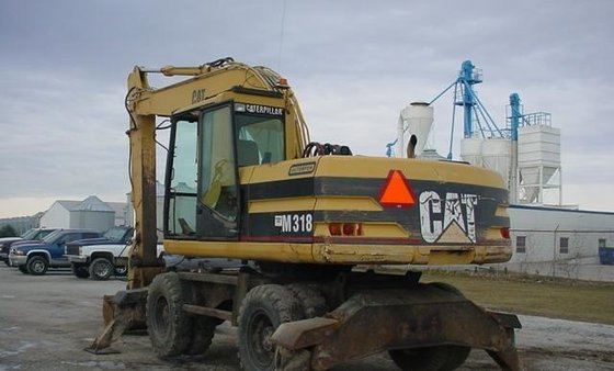 1999 Caterpillar M318 in Espergærde,