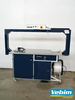 1987 strapping machine for packing