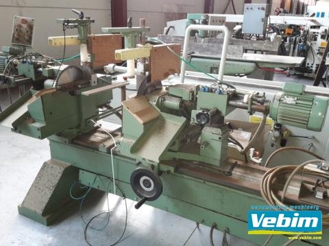 Twin mitre saw with end