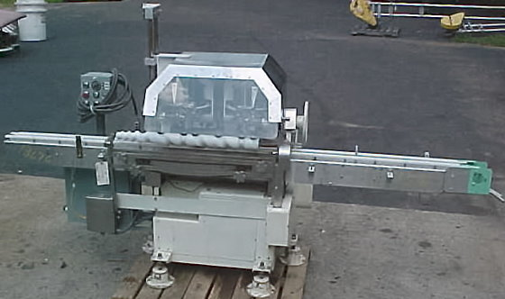 fully automatic dual station cottoner