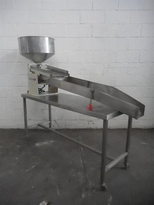 VIBRATORY FEEDER TABLET MOUNTED ON