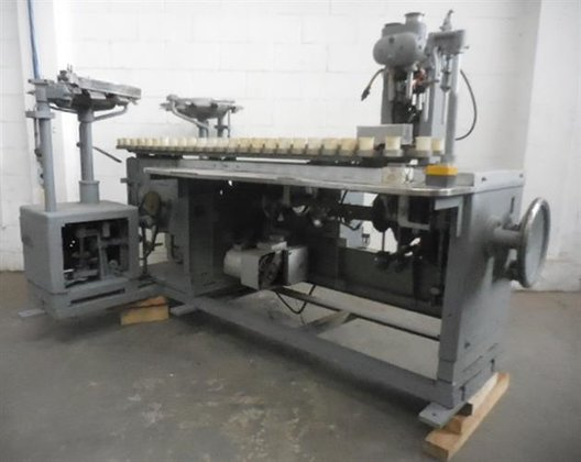 Arenco semiautomatic tube filler. -