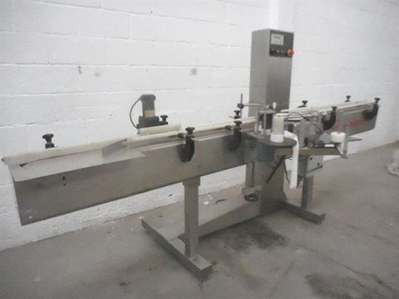 Equiteck stailess steel wraparound labeler.