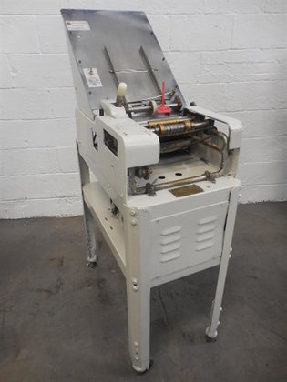 Labelette model 11AH wraparound labeler.