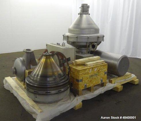liquid liquid separation by disc bowl centrifuge