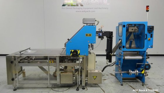 Used- GUK Literature Feeder System,