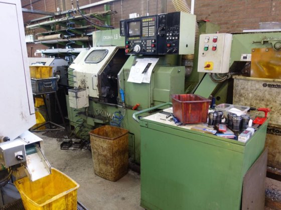 CNC lathe Okuma LB9 with bar loader in Netherlands