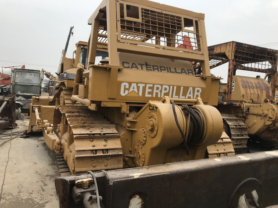 With CAT D7G dozer in Shanghai, China