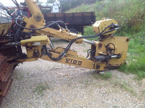 Komatsu D65EX-12 with Bron V-100 Cable Plow and Komatsu D65P