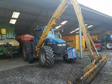 2001 New Holland TM 115 + Herde