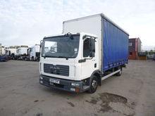 MAN TGL 7.150 tilt truck by auc