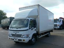 HINO 3815 closed box truck by a