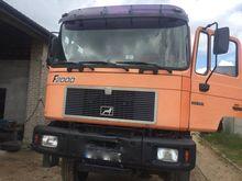1997 MAN 33-403 dump truck by a