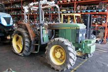 Damaged JOHN DEERE 6100 4WD whe