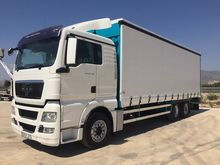 MAN TGX 26.480 tilt truck