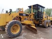 1998 CATERPILLAR 140M AWD grade
