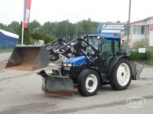 2002 HOLLAND TN65D with loader,
