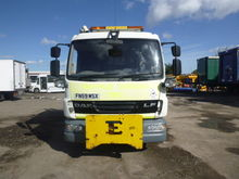 DAF LF45.180 flatbed truck by a