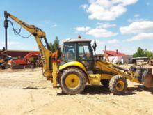2009 HOLLAND B110, excavator lo