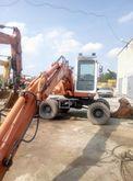 2000 ATLAS 1104 wheel excavator