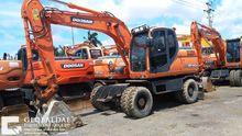 2012 DOOSAN DX140 wheel excavat