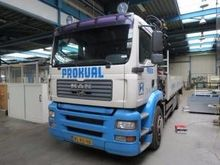 2001 MAN H05 flatbed truck by a