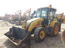 2001 FERMEC 860, excavator load
