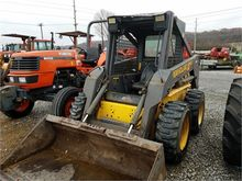 Used HOLLAND LS160 i