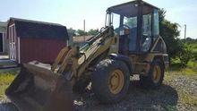 -1 Caterpillar 906 Rubber Tire