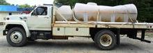 1987 Ford F700 - 1300 Gallon Wa