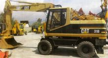 2003 Caterpillar 318 Wheel Exca