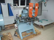 Eyeletting machine for rubber c