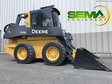 Used John Deere 318E