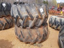(2) LOG SKIDDER TIRES & RIMS