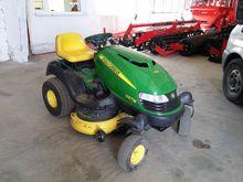 A self-propelled lawn mower Joh