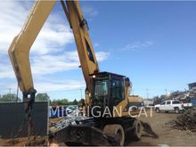 2006 CATERPILLAR M322C MH