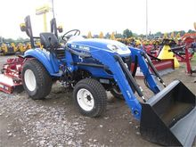 Used HOLLAND BOOMER