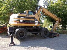 2002 Caterpillar M312 Wheel Exc