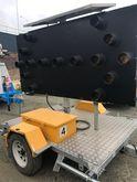 Mobile trailer mounted Arrow Bo