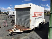 Enclosed trailer with drain cle