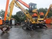 2004 CATERPILLAR M318C MH