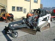 2005 Bobcat T 180 + graders