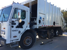 1998 Peterbilt 320 Rear Load Ga