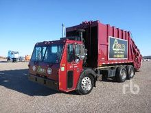 2000 Crane Carrier Comp COE T/A