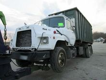 1991 Mack DM690S TA 22' Roll Of
