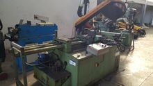 Sawing machine with automatic t